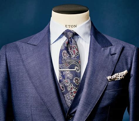 striped tie and checkered shirt beneath an elegant grey how to match your suiting eton shirts us