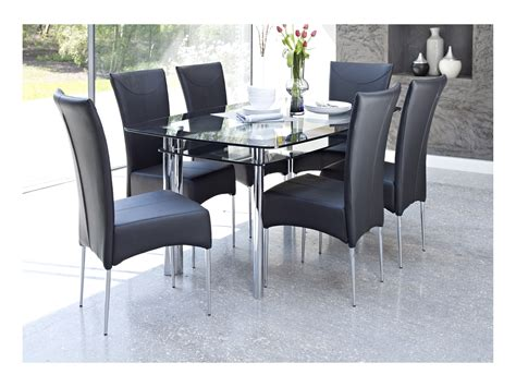 glass dining table with black chairs whatever