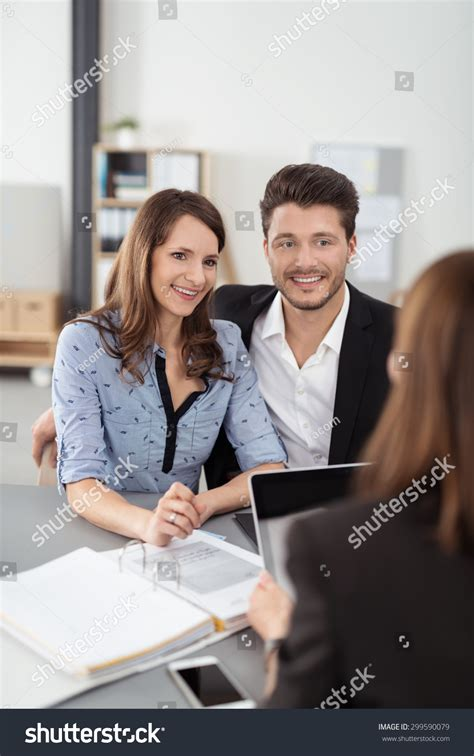 professional couple sweet happy young professional couple having a meeting
