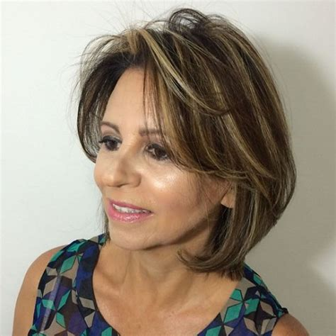 layered medium hairstyle for women over 60 joy behar