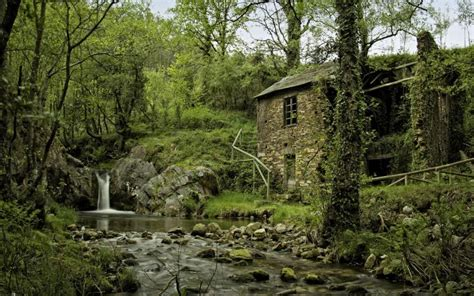 hd forest waterfall by ruins of a stone cottage wallpaper