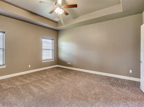 master bedroom designed with earth tones carpeting