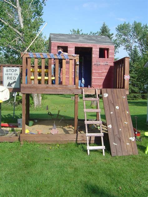 diy backyard fort kids fort swing set climbing rocks ladder slide fort
