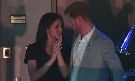 harry and meghan markle prince harry and meghan markle share a kiss at the