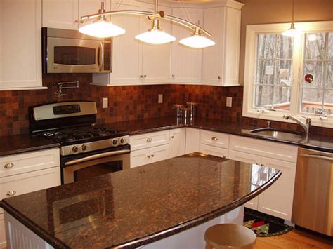 Brown Kitchen Cabinets With Granite Countertops by Brown Granite White Cabinets Backsplash Ideas