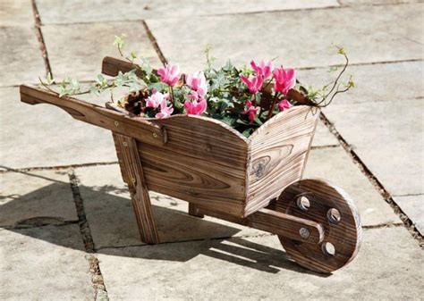 Decorative Wooden Planters by Decorative Wooden Wheelbarrow Planter H27cm X L62cm 163 12 99