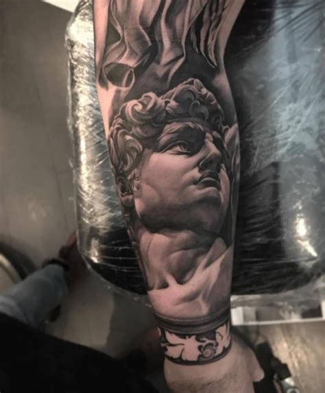 king david tattoo black and grey michelangelo s david on the forearm