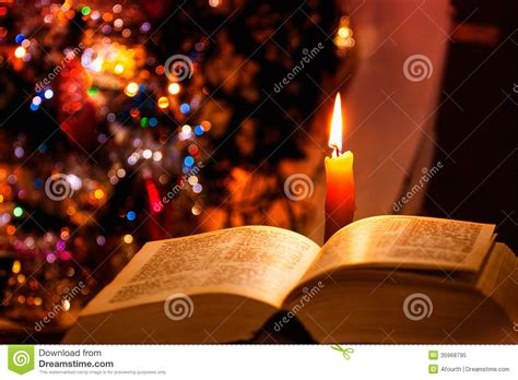 christmas holy bible vakyam pictures holy bible with candle on bokeh royalty free stock photo image 35968795