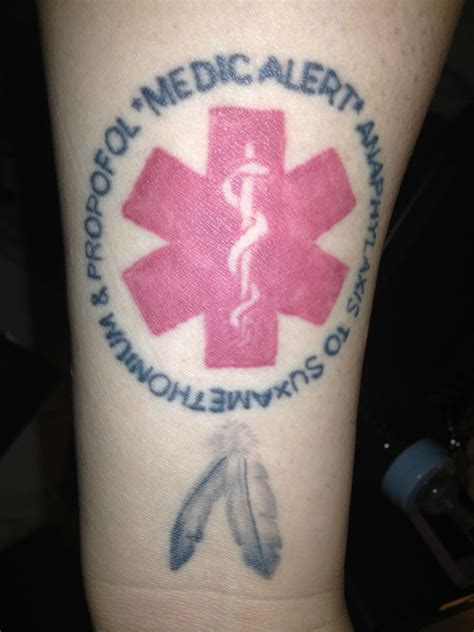 medical wrist tattoos medic alert on inner forearm just above wrist has