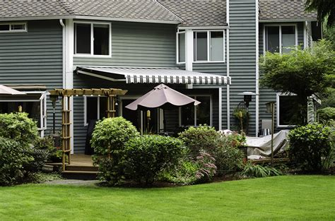 green awnings retractable deck awnings rainier shade