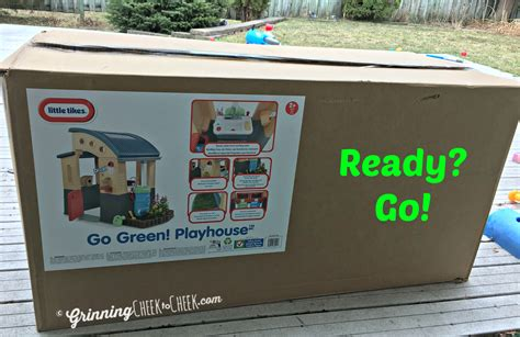 tikes green roof playhouse ready for with tikes grinning cheek to cheek