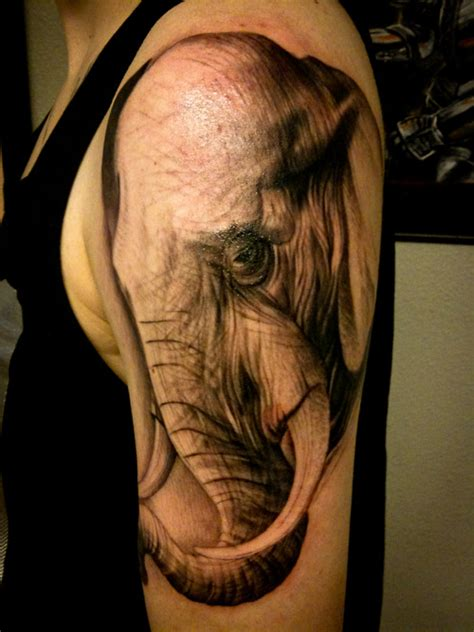 tattoo on shoulder face 53 beautiful elephant tattoos which will shock you picsmine