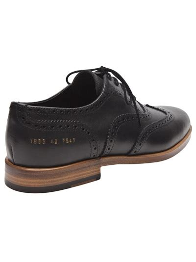 common projects wingtip shoe in black for lyst