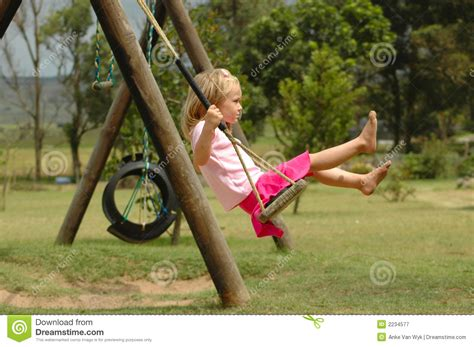 swinging the lifestyle child on swing stock image image of gorgeous active