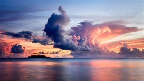 wallpaper  sea clouds horizon island sky sunset