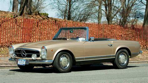 a vintage 1969 mercedes 280sl roadster