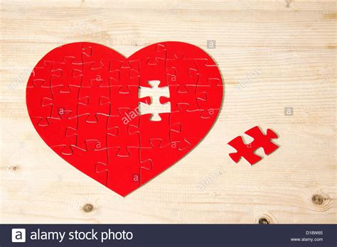 we love jigsaw puzzles the missing piece puzzle company heart shaped jigsaw puzzle with missing piece stock photo
