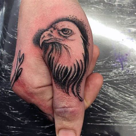 eagle tattoo in hand 90 thumb tattoos for men left and right digit design ideas