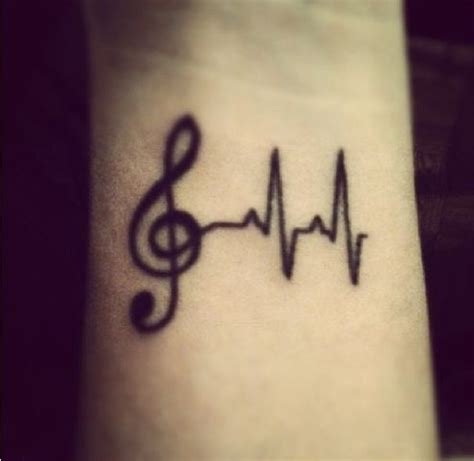 tattooed heart free music download music tattoo with heartbeat to symbolize music is always