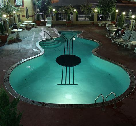 guitar shaped swimming pool guitar shaped pool flickr photo