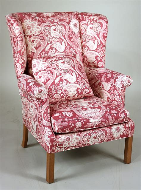 pale pink upholstered chair pink and white upholstered wing chair