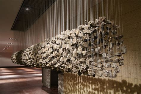 manipulating natural materials into suspended stone installations freshome com
