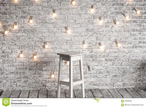 white wall with board and lights stock photo blank white stool against the backdrop stock photo image