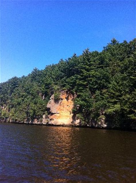pictured rocks boat tours dogs dog jumping across stand rock picture of dells boat
