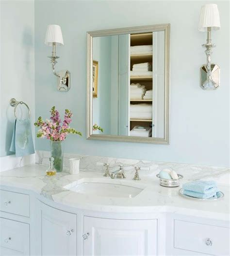 bath in blue a silver frame vanity mirror