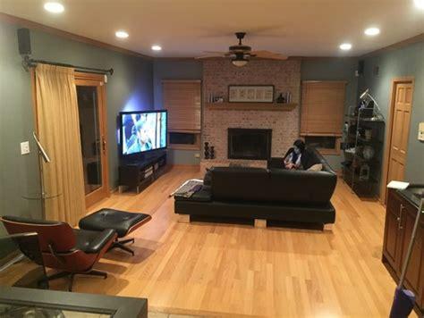 color rug  black couch grey walls
