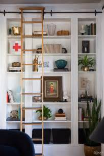 ladder bookshelves ikea the sliding library ladder gives the built ins an