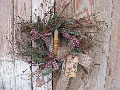 primitive christmas winter twiggy german pine berry  rusty star wreath  timer candle