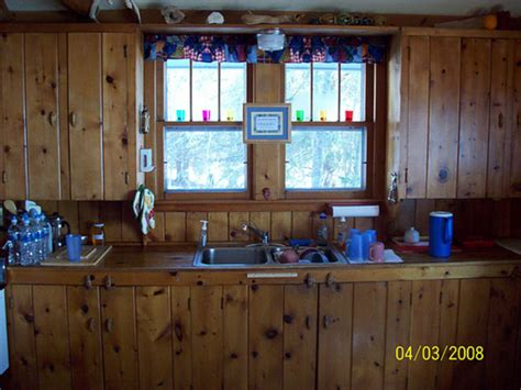 rustic kitchen with wood wall paneling design bookmark 2030
