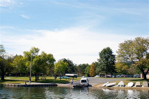 boat finder pa a john boat is launched while people enjoy picnicking at