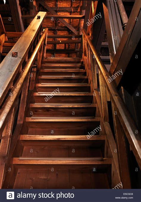 wooden staircase wooden staircase leading upstairs in a historic