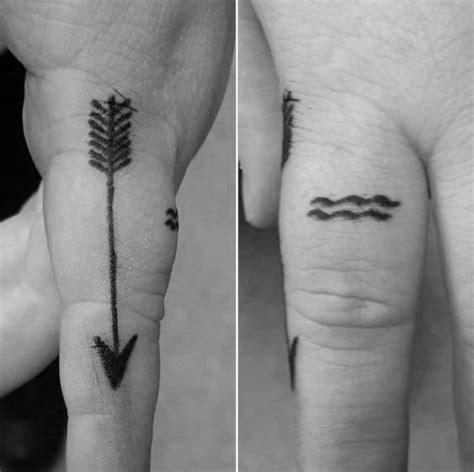 aquarius tattoo on finger 70 aquarius tattoos for men astrological ink design ideas