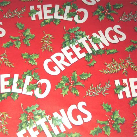 vintage christmas wrapping paper or gift wrap with holly and
