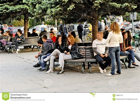 people sitting on a park bench people sitting on a park bench in bitola editorial photo image 40861101