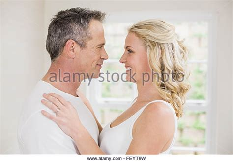 images of love kiss in bed couple mature bed kiss kissing love romance stock photos
