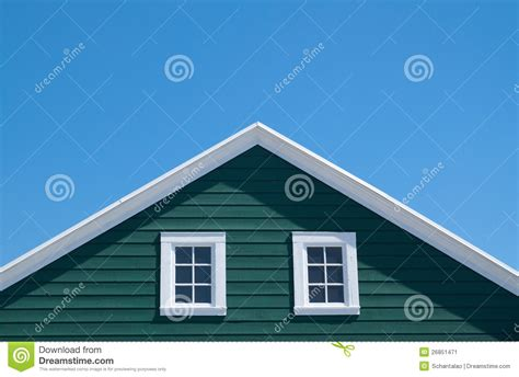 Shingle House Plans green house and white roof with blue sky stock image