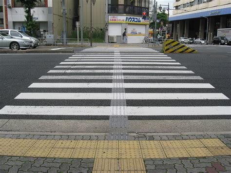 at the crossing file pedestrian crossing with textured paving blocks jpg