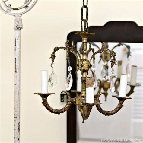 The Junkyard Chandelier Junk Chandelier Swings From Antique L Stand Petticoat Junktion