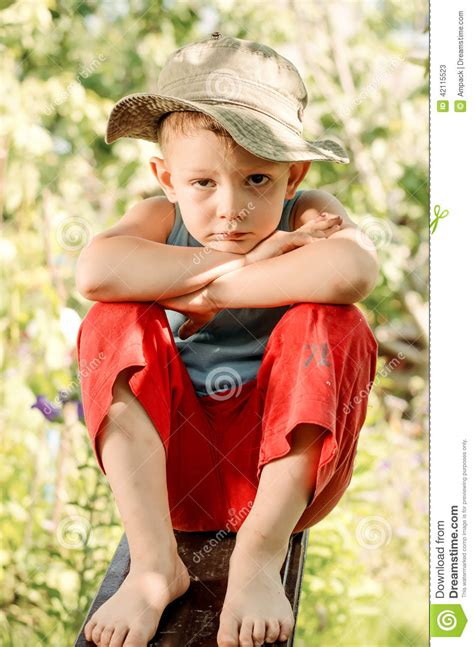 boys barefoot preteen thoughtful young boy staring at the camera stock image