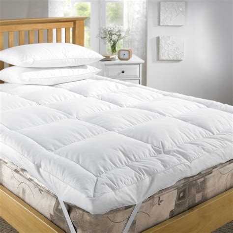 bed and mattress everything you need to know about feather bed topper