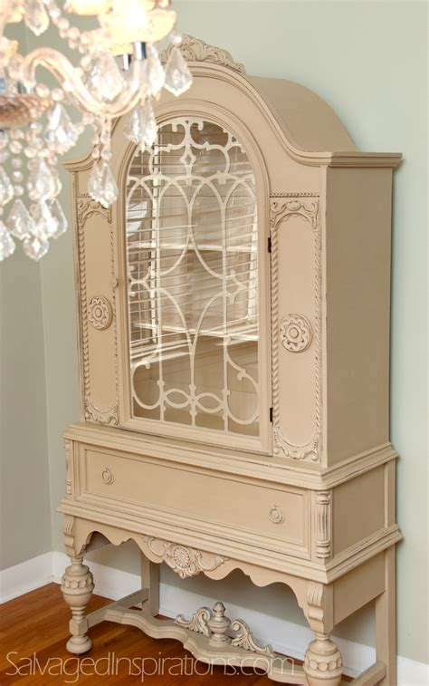 a small world and a custom chalk painted china cabinet