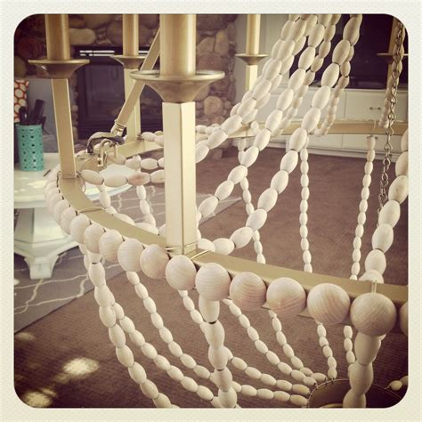 diy wood bead chandelier upcycle a plain chandelier into a beaded showpiece