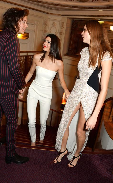 Harry styles flirts with kendall jenner while partying with cara