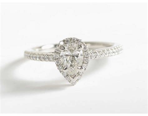 pear shaped halo engagement ring in platinum