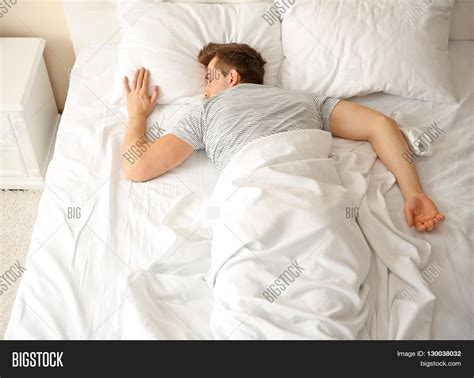 guy in bed young man sleeping alone white big image photo bigstock