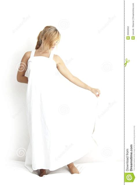 bed dress young girl in a white dress on the bed stock photography